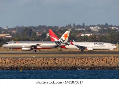 Sydney, Australia - October 7, 2013: Jetstar Airways Airbus A320 twin engine passenger aircraft at Sydney Airport with a Qantas Boeing 737.