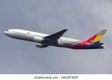 Sydney, Australia - October 7, 2013: Asiana Airlines Boeing 777 large twin engine commercial aircraft taking off from Sydney Airport.