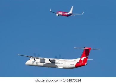 Sydney, Australia - October 7, 2013: QantasLink de Havilland Canada (Bombardier) Dash 8 (DHC-8-402Q) twin engine turboprop regional airliner aircraft taking off from Sydney Airport.