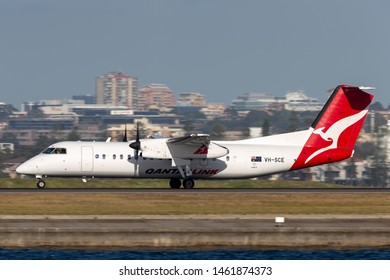 Sydney, Australia - October 7, 2013: QantasLink (Eastern Australia Airlines) de Havilland Canada Dash 8 twin engine turboprop regional airliner aircraft taking off from Sydney Airport.