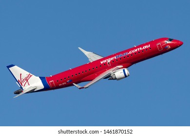 Sydney, Australia - October 9, 2013: Virgin Blue Airlines Embraer E-190 twin engine regional jet airliner taking off from Sydney Airport.