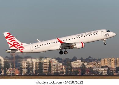 Sydney, Australia - October 9, 2013: Virgin Australia Airlines Embraer E-190 twin engine regional jet airliner taking off from Sydney Airport.