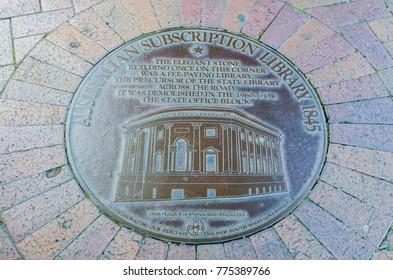 "SYDNEY, AUSTRALIA. – On December 14, 2017. - Pavement Plaque ""Australian subscription library 1845"" on the ground at Circular Quay."