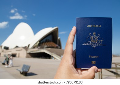 SYDNEY, AUSTRALIA. – On December 14, 2017. - A man's hand holding Australia passport with blurred background of Sydney Opera House for Concepts of traveling.