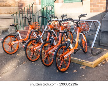 "SYDNEY, AUSTRALIA. – On February 03, 2019. - Orange wheels bicycle ""Mobike (bike sharing)"" is dockless system uses a smartphone app to unlock bicycles, charging an hourly rate for use."