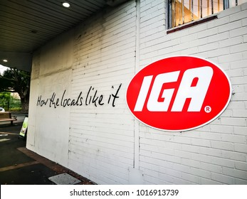 "SYDNEY, AUSTRALIA – On February 4, 2018. – IGA (Australian supermarket group) brand logo on a wall with slogan ""How the locals like it"""