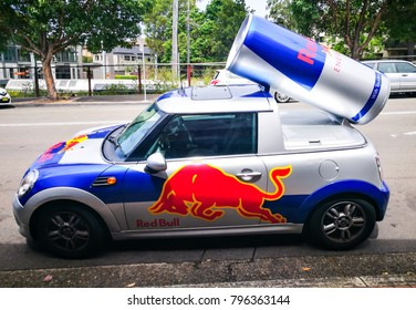 SYDNEY, AUSTRALIA – On January 16, 2018. – Red Bull energy drink mini cooper publicity car with a can of red bull drink behind. Used for promotion.