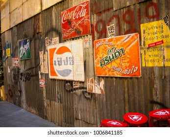 SYDNEY, AUSTRALIA – On January 6, 2013. – Mirinda orange drink, Pepsi vintage logos in Thai language version attached on old galvanized iron wall.