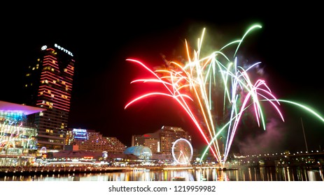 SYDNEY, AUSTRALIA. – On November 03, 2018. – Beautiful rainbow colors fireworks with cityscape view of Darling harbour at Cockle Bay, New South Wales.