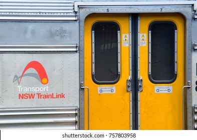 SYDNEY, AUSTRALIA. – On November 19, 2017. - The yellow train door with Transport nsw Trainlink logo in close up, at Central railway station.