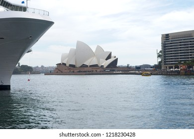 Sydney, Australia - Scenic panoramic view from Circular Quay with Sydney Opera House in the background and bow of cruise ship in the foreground.