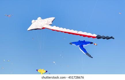 "Sydney, Australia - September 13, 2015: Colorful Kites Flying in blue spring sky at the Kite Festival called "" Festival of the Winds"""
