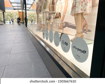 Sydney, Australia - September 14, 2019: Afterpay and Zip Pay logos on the front of a retail store. Afterpay and ZipPay are buy now pay later service providers.