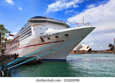 Sydney, Australia - September 15, 2013:  Carnival Spirit, of Carnival Cruise Lines,, at its dock port at Sydney Harbour. Passengers await its departure for a 12 night Pacific Islands Cruise.