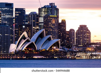 Sydney, Australia - September 16, 2016: The iconic Sydney Opera House, landmark of the city, with the skyline in Sydney, Australia. Front view after sunset.