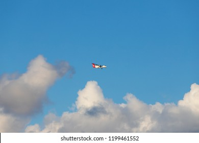 Sydney, Australia - September 4, 2018: Qantas ATR 72 in a cloudy sky.