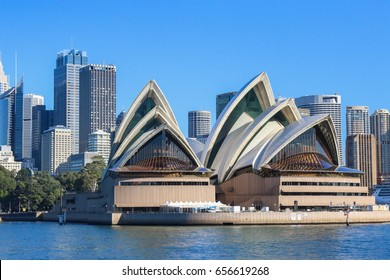 In Sydney Australia - Wednesday May24, 2017: Sydney Opera house close up with office buildings of Sydney Central Business District on the background. Circular Quay, Sydney Harbour
