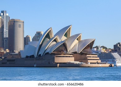 In Sydney Australia - Wednesday May24, 2017: Sydney Opera house close up with office buildings of Sydney Central Business District on the background. Circular Quay, Sydney Harbour.