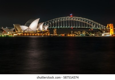 Sydney/ Australia-February 10, 2016: Image of Sydney at night with iconic Opera House and Sydney Harbour Bridge, taken from Mrs. Macquarie 's Chair.