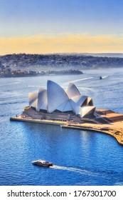 Sydney, Autralia - 20 June 2020: Sydney Opera house on Sydney harbour in soft morning light.