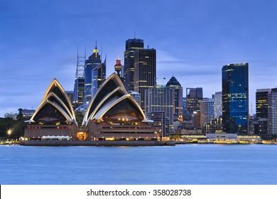 Sydney city CBD landmarks at blue sunset as seen from Kirribilli over harbour