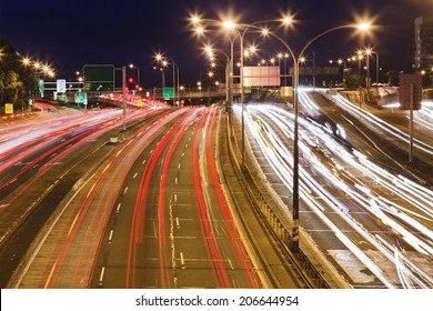 Sydney city motorway at sunset with blurred long exposure traffic vehicles lights and motion rush hour