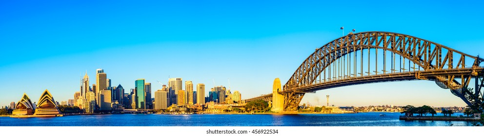 Sydney city skyline panorama with the famous Habour bridge on a clear sunny day.