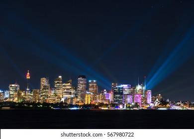 Sydney cityscape at night with colorful lights illuminating modern city skyline