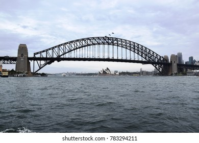 Sydney, December 2017 - Sydney Harbour Bridge, and Opera House on the background, in the Bay of Sydney, Australia