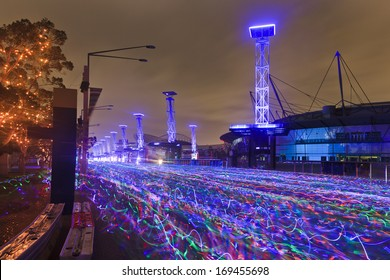 sydney electric run charity running festival after sunrise blurred river of racing athletes with neon glow sticks at olympic park