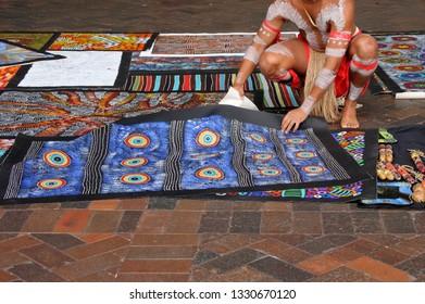 SYDNEY - FEB 21 2019Indigenous Australian artist man saling artwork in Sydney New South Wales, Australia. Aboriginal Australians comprise 3.1% of Australia's population.