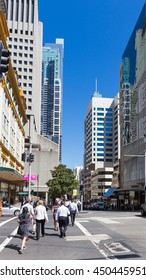 Sydney - February 25, 2016: People on Elizabeth Street and the blue sky over the skyscrapers of February 25, 2016, Sydney, Australia