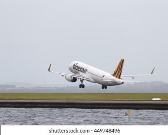 Sydney - February 26, 2016: Big passenger Airbus A320-232 Tiger Airways Australia, takes off on runway at Sydney Airport February 26, 2016, Sydney, Australia