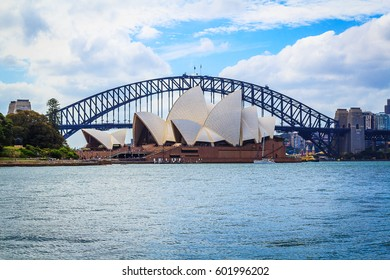 SYDNEY - February 5 2017: View of the iconic Sydney Opera House from the Royal Botanical Garden, with the Sydney Harbour Bridge in the background, on February 5, 2017 in Sydney, Australia.