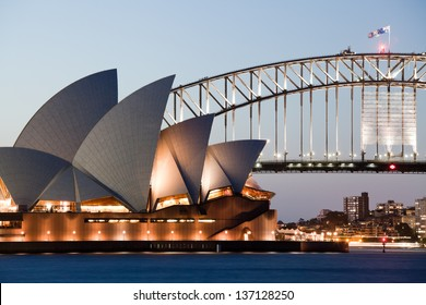 SYDNEY - FEBRUARY 6: The Sydney Opera House with Harbor bridge in Sydney, Australia on February 6, 2013. Designed by Danish architect Jorn Utzon; this year is celebrating the 40th opening anniversary