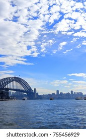 Sydney harbor bridge with ferries against the misty blue sky