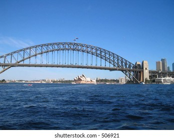 sydney harbor bridge with the opera house in the background