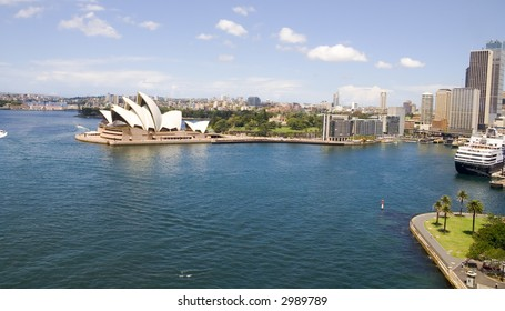 Sydney Harbor, opera house with buildings, buildings, and ships