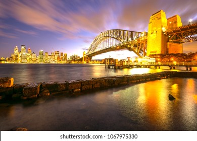 Sydney Harbour Bridge building landmarks skyline city at dusk, Australia.