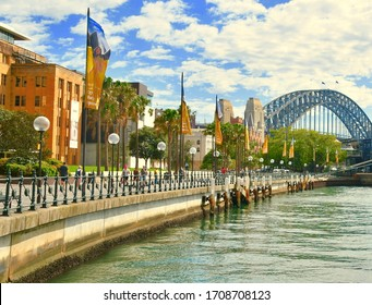 Sydney Harbour Bridge and Circular Quay walkway beside the museum of Contemporary Art. Popular tourist location and ferry terminal in Sydney Port Jackson. Sydney Australia. April 2020
