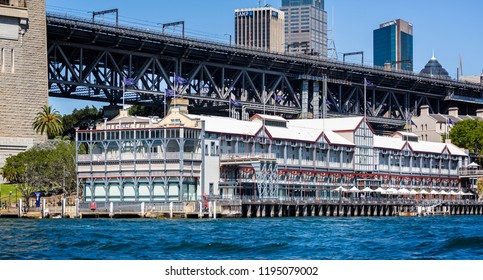 Sydney Harbour Bridge looming over luxury waterfront Hotel at Dawes Point, Sydney, NSW, Australia on 25 September 2013