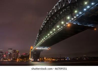 Sydney Harbour Bridge on a dark, storm night.