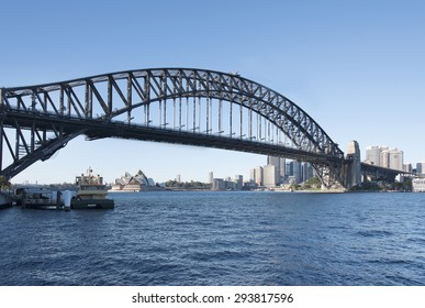 Sydney Harbour bridge and opera house with clear blue sky
