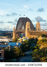 Sydney Harbour Bridge and skyline under the golden sunlight.