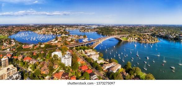 Sydney Inner west suburbs on shores of Parramatta river around Gladesville bridge towards West and distant Parramatta CBD.
