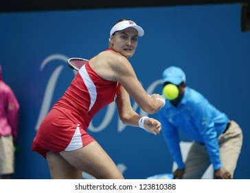 SYDNEY - JAN 7: Nadia Petrova from Russia stretches for a backhand in her first round match in the APIA Sydney Tennis International. Sydney January 7, 2013.