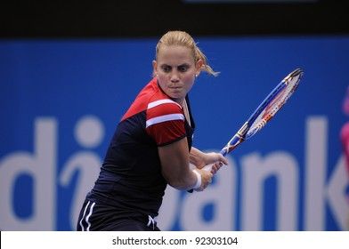 SYDNEY - JAN 8: Australia's Jelena Dokic hits a backhand in her first round match in the APIA Tennis International. Sydney - January 8, 2012