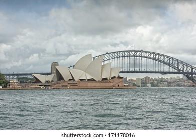 SYDNEY - JANUARY 12: Sydney Opera House view on January 12, 2014 in Sydney, Australia. The Sydney Opera House is a famous arts center. It was designed by Danish architect Jorn Utzon.