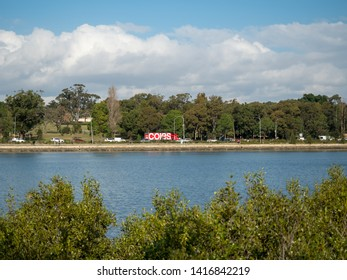 Sydney June 2nd 2019 - Around The Bay Run, Iron Cove in a cloudy winter afternoon and Coles Truck driving along the West link background blur
