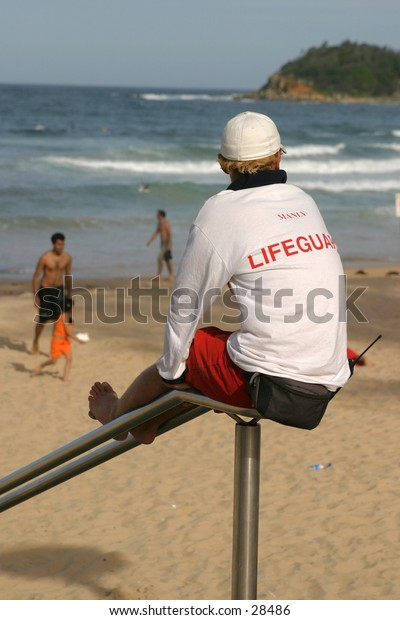 Sydney Manly beach lifeguard looking out for people.